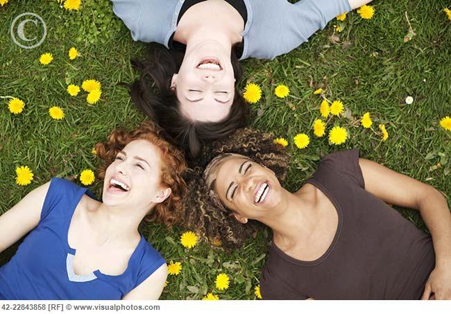 Women lying in the grass